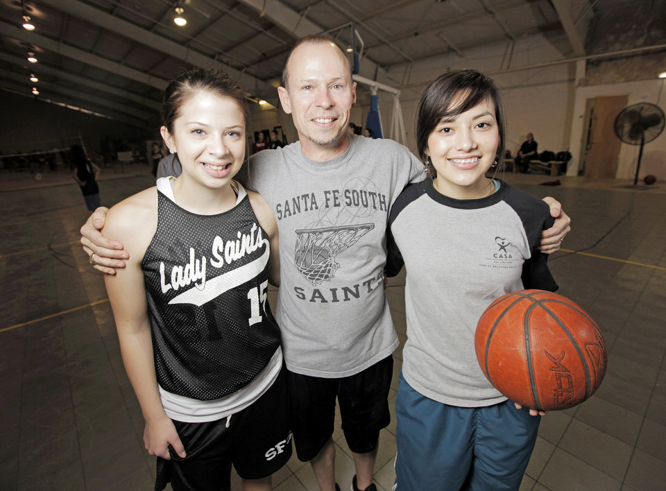 Santa Fe South girls high school basketball players Rachel Boyd, left, and Stephany Galaviz, right, pose for a photo with coach Danny Boyd in Oklahoma City, Wednesday, Feb. 15, 2012. Photo by Nate Billings, The Oklahoman