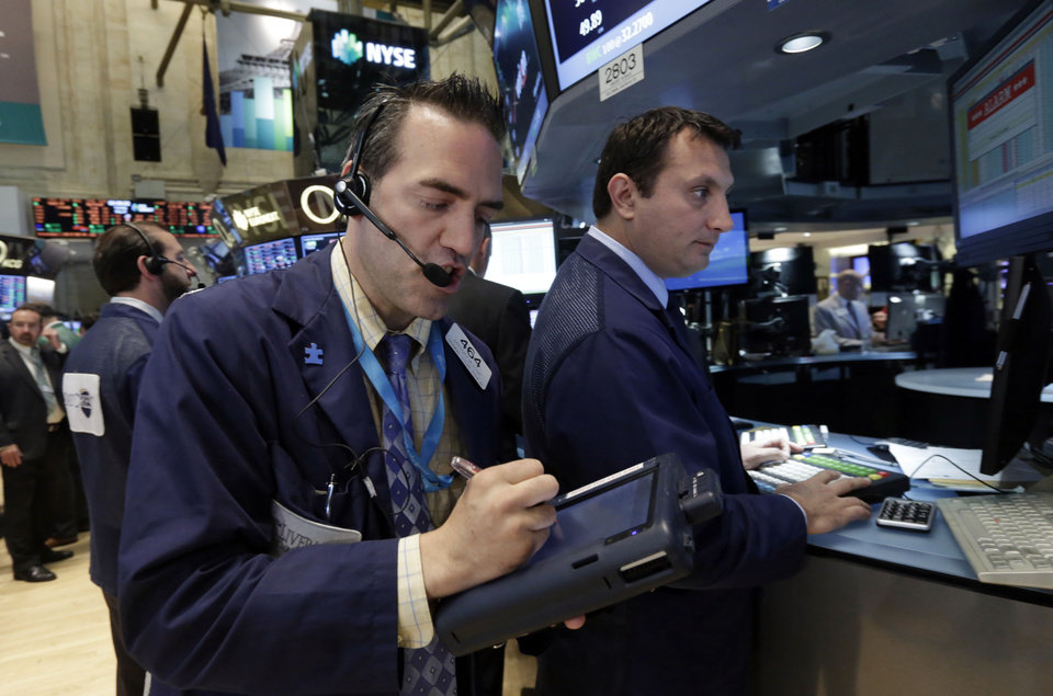 Photo - Trader Gregory Rowe, left, works on the floor of the New York Stock Exchange Tuesday, May 27, 2014. Stocks rose Tuesday after the government reported that orders for big-ticket items rose unexpectedly last month. (AP Photo/Richard Drew)