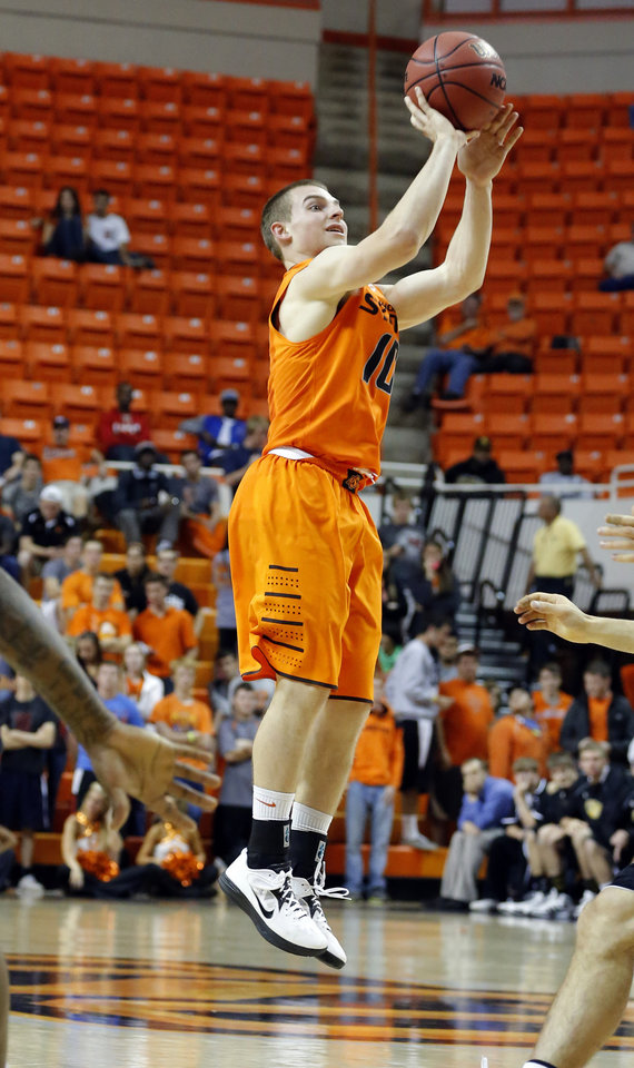 Oklahoma State's Phil Forte takes a shot during the college basketball game between Oklahoma State University and Ottawa (Kan.) at Gallagher-Iba Arena in Stillwater, Okla., Thursday, Nov. 1, 2012. Photo by Sarah Phipps, The Oklahoman