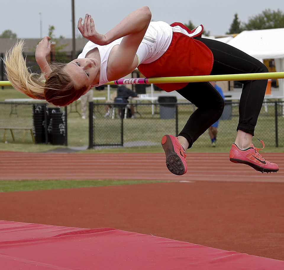Photo - Carl Albert's Madison Hunter competes in the Class 5A girls high jump during the Class 6A and 5A state championship track meet at Yukon High School on Saturday, May 17, 2014 in Yukon, Okla.   Photo by Chris Landsberger, The Oklahoman