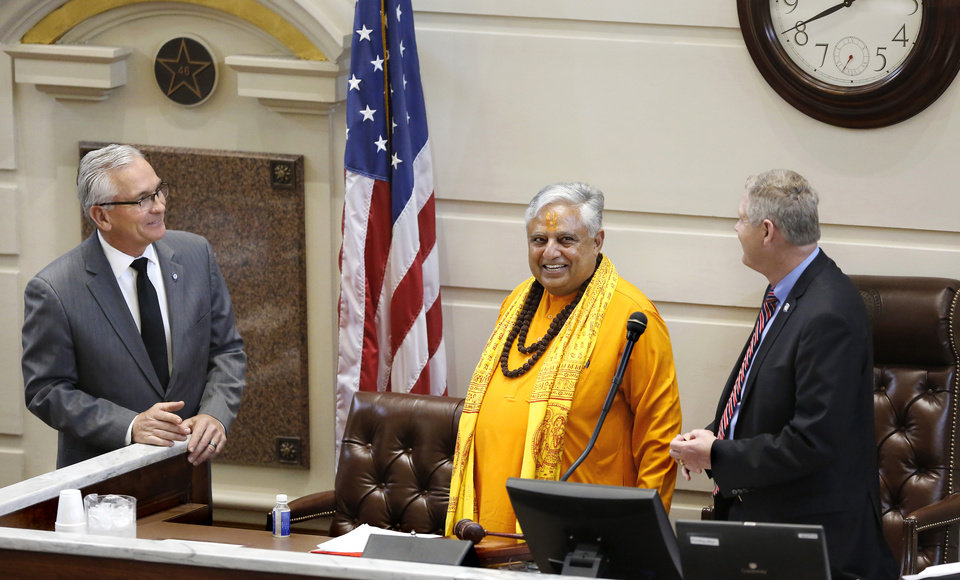 Photo -  Hindu statesman Rajan Zed laughs while speaking with senators Darcy Jech, R-Kingfisher, left, and Gary Stanislawski, R-Tulsa, after Zed delivered the invocation for Monday's Senate session at the State Capitol. [Photo by Jim Beckel, The Oklahoman]