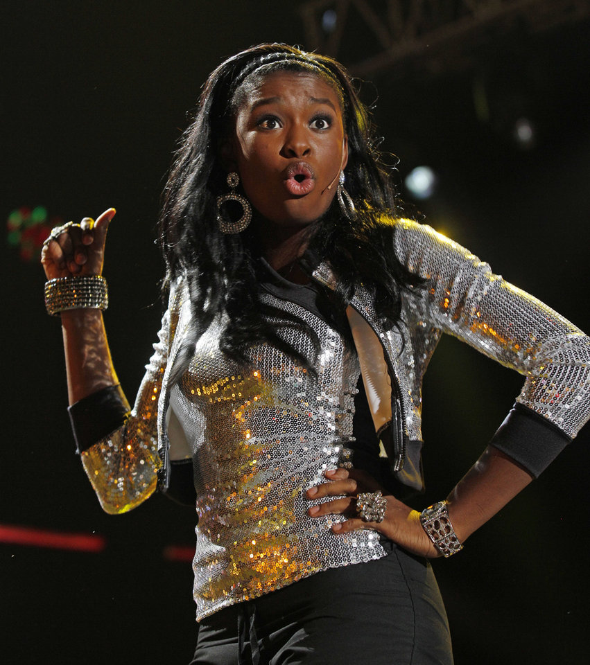 Photo -   Singer Coco Jones performs at the Essence Music Festival in New Orleans, Thursday, July 5, 2012. This is the first day of the four day music festival. (Photo by Bill Haber/Invision/AP)