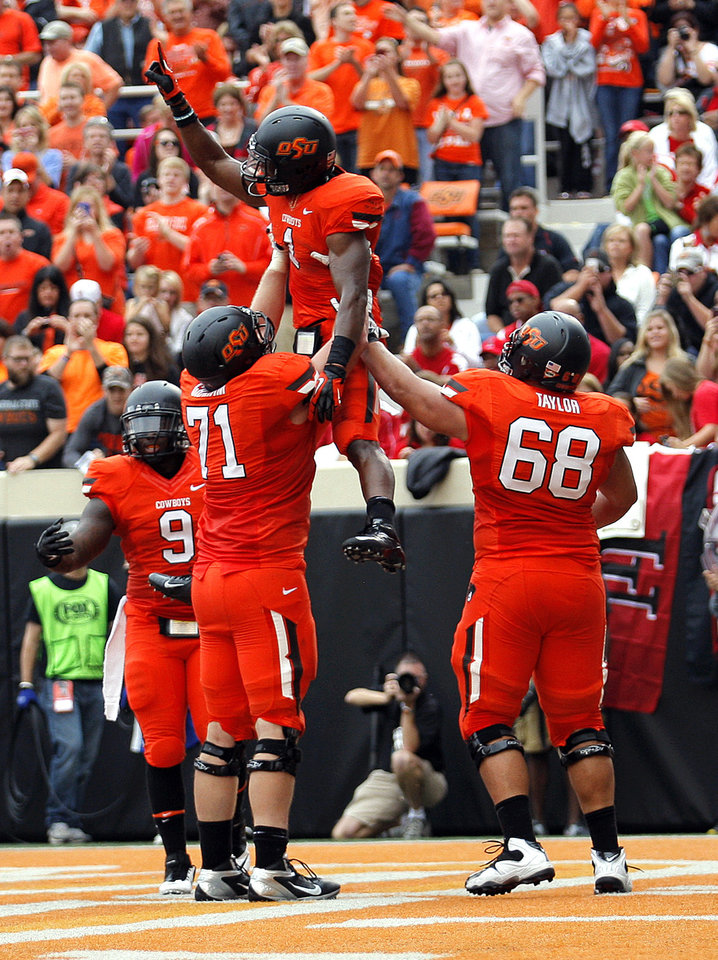 Oklahoma State\'s Kye Staley (9), Parker Graham (71) and Lane Taylor (68) celebrate a touchdown with Joseph Randle (1) during a college football game between Oklahoma State University (OSU) and the University of Louisiana-Lafayette (ULL) at Boone Pickens Stadium in Stillwater, Okla., Saturday, Sept. 15, 2012. Photo by Sarah Phipps, The Oklahoman