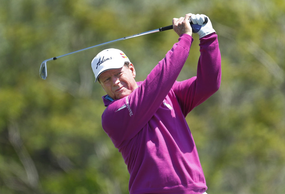 Photo - Tom Watson hits a tee shot on the fourth hole during the third round of the 75th Senior PGA Championship golf tournament at Harbor Shores Golf Club in Benton Harbor, Mich., Saturday, May 24, 2014. (AP Photo/Paul Sancya)