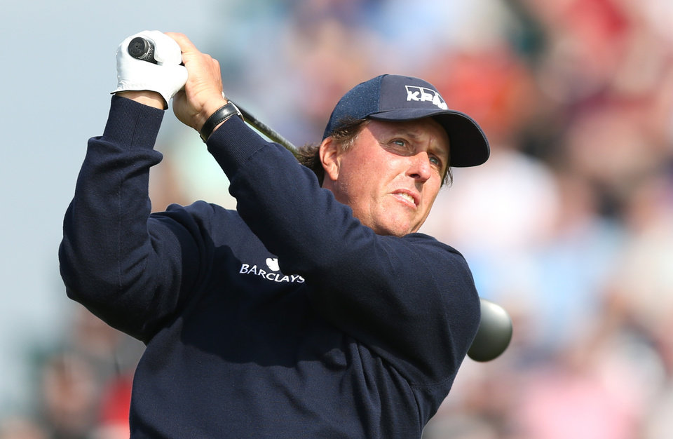 Photo - Phil Mickelson of the US plays a shot off the 3rd tee during the second day of the British Open Golf championship at the Royal Liverpool golf club, Hoylake, England, Friday July 18, 2014. (AP Photo/Scott Heppell)