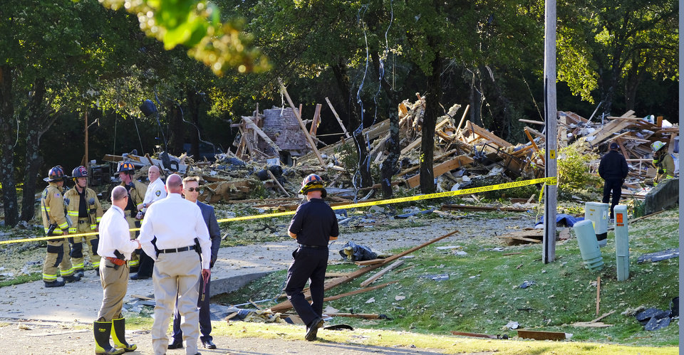 Photo - Investigators and firefighters at the scene of a house explosion in the 8000 block of NE 139th St. in Oklahoma City, Thursday, September 24, 2020. [Doug Hoke/The Oklahoman]