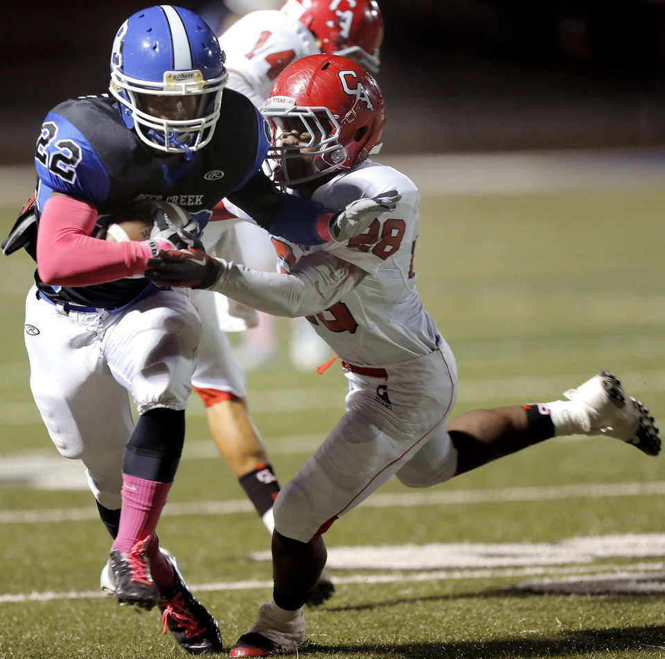 Photo - Deer Creek's Marcus Coleman tries to get by Carl Albert's Keshon Harris during the high school football game between Deer Creek and Carl Albert at Deer Creek High School, Friday, Sept. 21, 2012.  Photo by Sarah Phipps, The Oklahoman