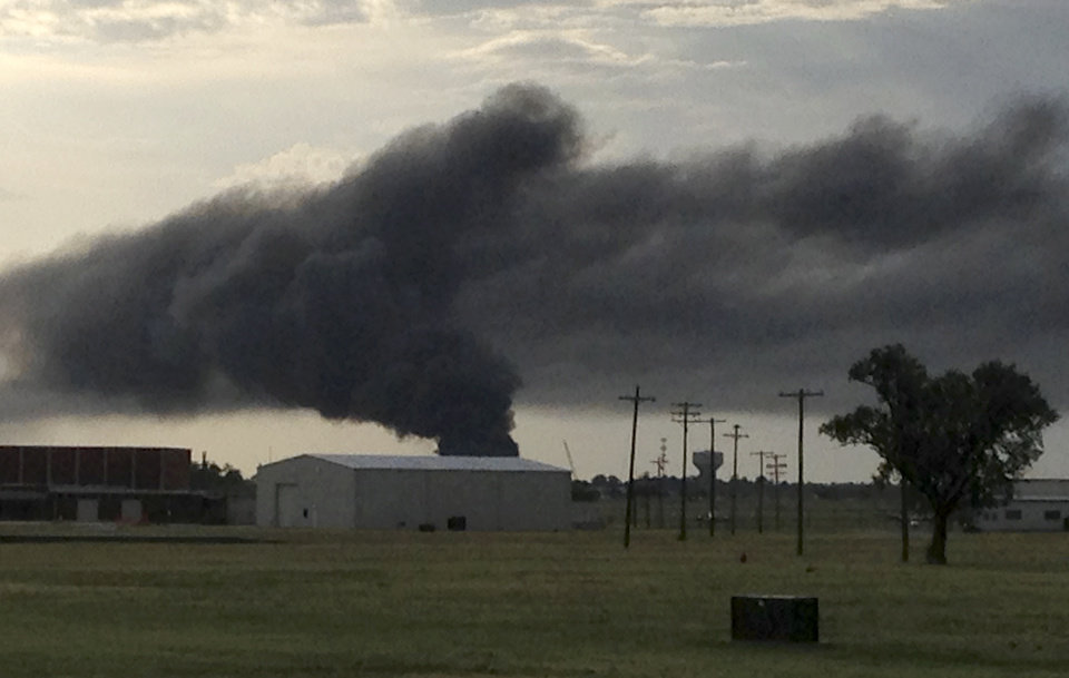 Photo - A fire burns near I-35 north of Robinson in Norman, Okla., Wednesday, July 10, 2013. Photo by William Crum, The Oklahoman