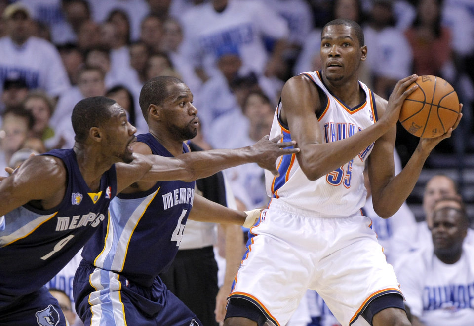 Oklahoma City's Kevin Durant (35) looks to pass the ball as Tony Allen (9) of Memphis and Sam Young (4) defend him during game five of the Western Conference semifinals between the Memphis Grizzlies and the Oklahoma City Thunder in the NBA basketball playoffs at Oklahoma City Arena in Oklahoma City, Wednesday, May 11, 2011. Photo by Sarah Phipps, The Oklahoman