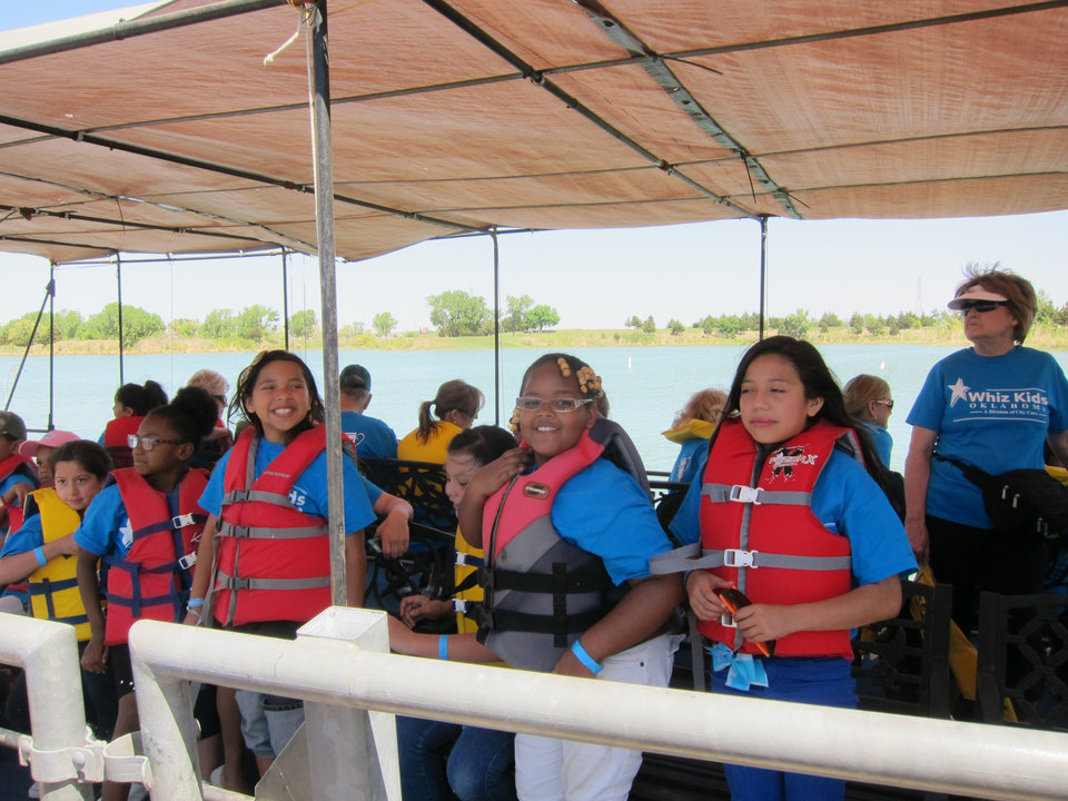 "Children involved with Whiz Kids ride on a boat during the faith-based program's recent ""Spring Fling"" end-of-year celebration at Crystal Lake in Oklahoma City. Photo by Carla Hinton, The Oklahoman   <strong></strong>"