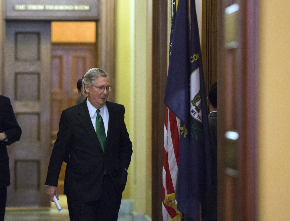 Photo - Senate Minority Leader Mitch McConnell, from Kentucky, departs the Strom Thurmond room after a Senate Republican caucus meeting about the fiscal cliff, on Capitol Hill, Monday, Dec. 31, 2012 in Washington. (AP Photo/Alex Brandon)
