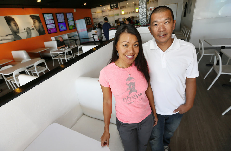 Photo -  Mary Nhin and Kang Nihn, owners of Nhinja Sushi & Wok restaurants, pose for a photo in their store at 13905 N. May Ave., in Oklahoma City.   Photo by Nate Billings, The Oklahoman   NATE BILLINGS -
