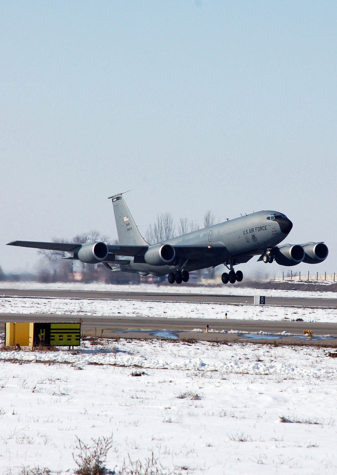 Photo - In this Feb. 6, 2009 image provided by the U.S. Air Force a KC-135 Stratotanker takes off from Manas Air Base, Kyrgyzstan, for a refueling mission over Afghanistan. An American KC-135 military refueling plane carrying three crew members crashed Friday, May 3, 2013, in the rugged mountains of Kyrgyzstan, the Central Asian nation where the U.S. operates an air base key to the war in Afghanistan. (AP Photo/U.S. Air Force, Senior Master Sgt. Julie Layton)