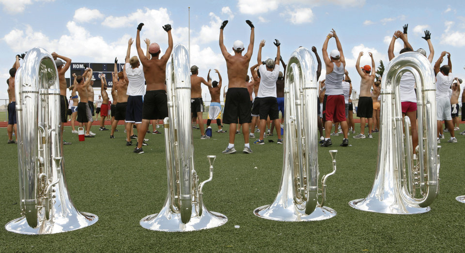 The brass section of the Blue Devils Drum and Bugle Corps from Concord, California, warm up before practice at Edmond North High School in Edmond, Okla., Tuesday, July 20, 2010. Seven top drum corps are competing at UCO. Photo by Paul Hellstern, The Oklahoman