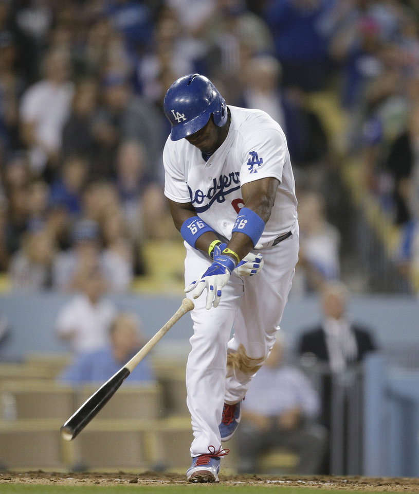 Photo - Los Angeles Dodgers' Yasiel Puig slams his bat to the ground after hitting a fly ball during the fifth inning of a baseball game against the Pittsburgh Pirates on Friday, May 30, 2014, in Los Angeles. (AP Photo/Jae C. Hong)