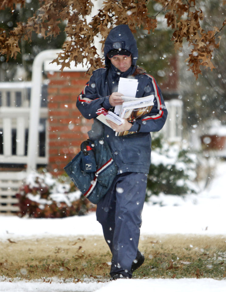 USPS City Carrier Jack Tanksley makes his rounds through falling snow in a neighborhood in downtown Edmond, OK, Tuesday, February 12, 2013,  By Paul Hellstern, The Oklahoman