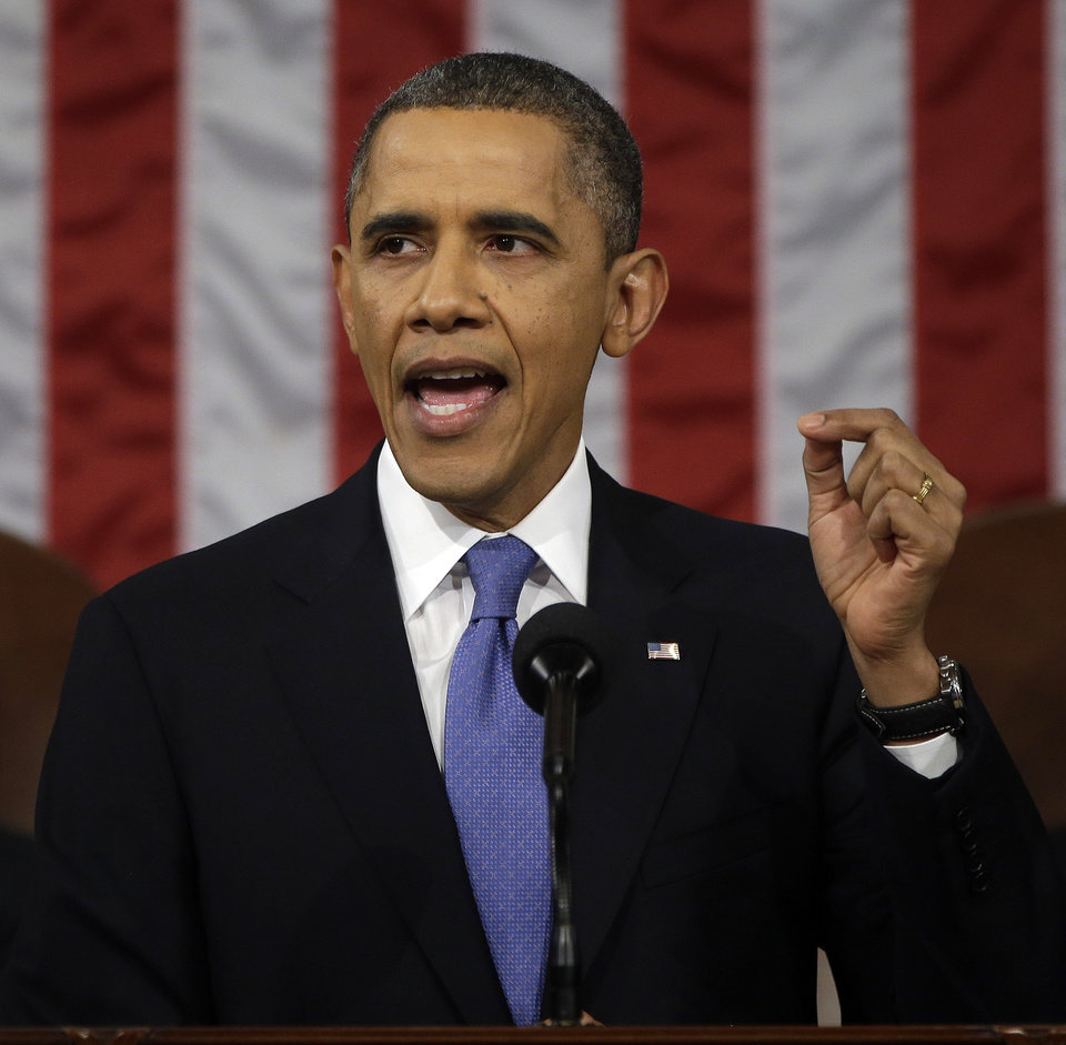 President Barack Obama gestures as he gives his State of the Union address during a joint session of Congress on Capitol Hill in Washington, Tuesday Feb. 12, 2013. (AP Photo/Charles Dharapak, Pool) ORG XMIT: CAP519