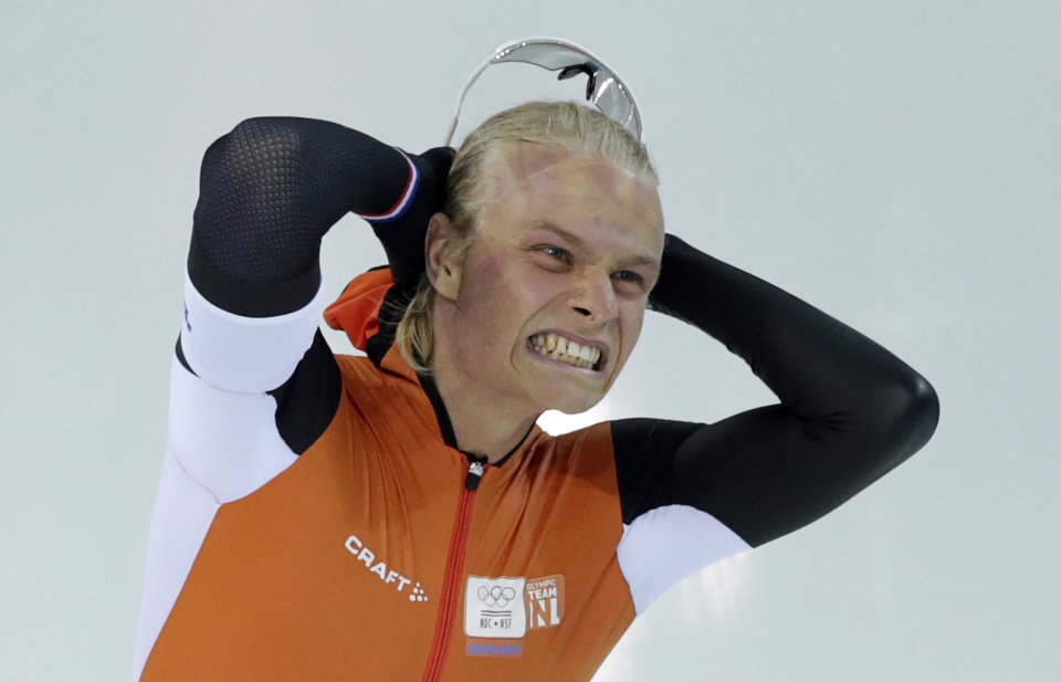 Photo - Silver medallist Koen Verweij of the Netherlands grabs his hair when the race was declared a tie with gold medallist Poland's Zbigniew Brodka  in the men's 1,500-meter speedskating race at the Adler Arena Skating Center during the 2014 Winter Olympics in Sochi, Russia, Saturday, Feb. 15, 2014. Verweij later was later declared silver, losing by three thousandth of a second. (AP Photo/Matt Dunham)
