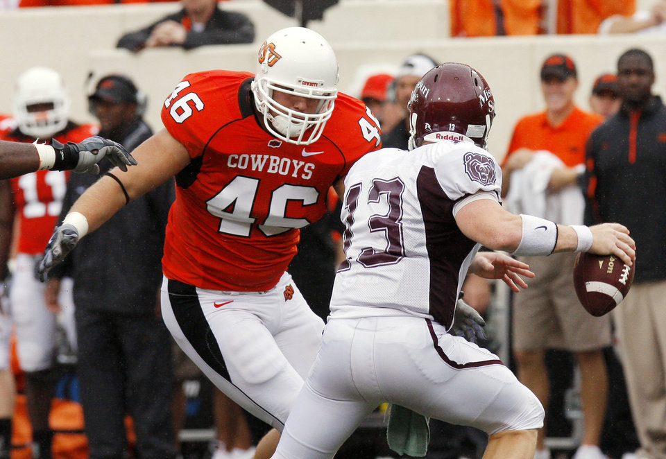 Photo - Shane Jarka rushes Cody Kirby at the Oklahoma State University (OSU) football game against Missouri State University (MSU) Saturday Sept. 13, 2008 at Boone Pickens Stadium in Stillwater, Okla. BY DOUG HOKE, THE OKLAHOMAN.