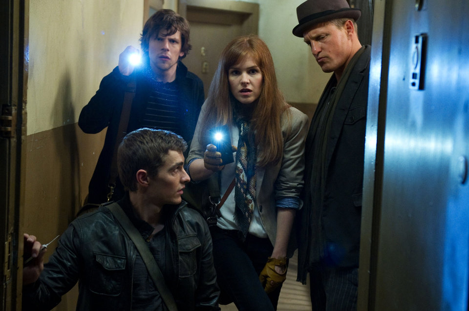 Photo - This undated publicity photo released by Summit Entertainment, LLC shows, clockwise from bottom, Dave Franco, Jesse Eisenberg, Isla Fisher and Woody Harrelson, in a scene from the film,