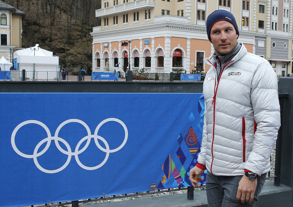 Photo - Norway's Aksel Lund Svindal takes a walk through the streets of the Rosa Khutor ski resort in Krasnaya Polyana, Russia at the Sochi 2014 Winter Olympics, Monday, Feb. 17, 2014. Svindal is leaving the Olympics because he has problems with allergies and fatigue, the Norwegian men's Alpine skiing coach said Monday. (AP Photo/Christophe Ena)