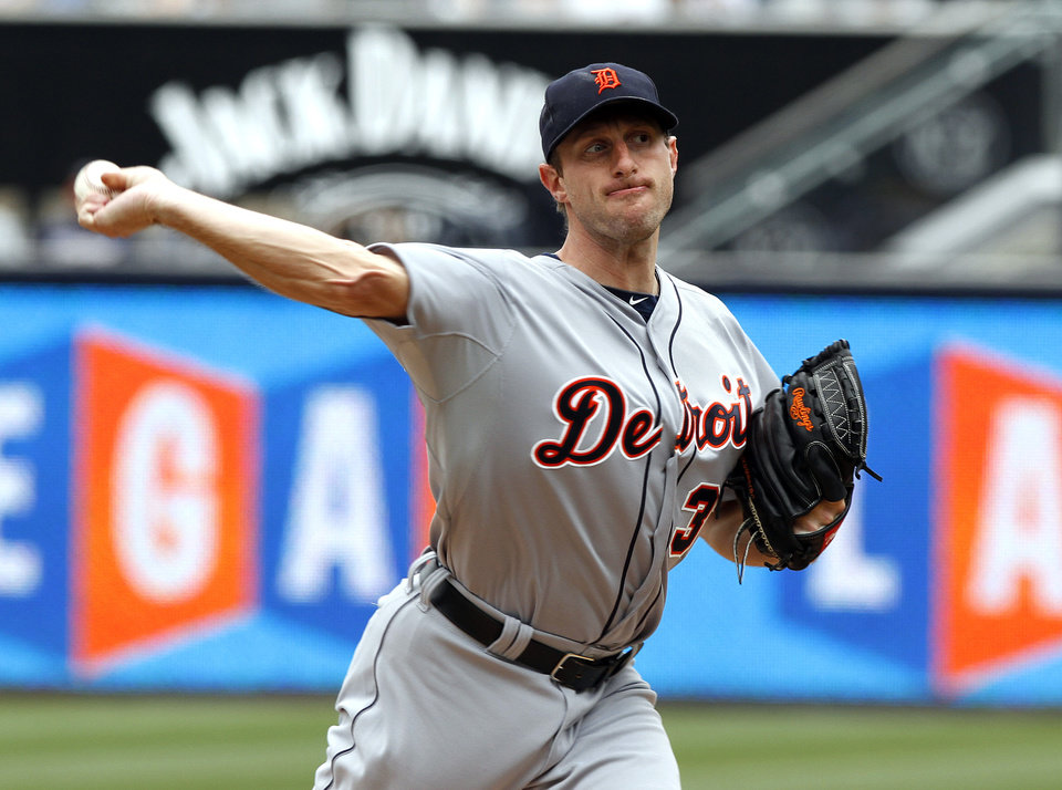 Photo - Detroit Tigers starting pitcher Max Scherzer pitches in the first inning of a baseball game against the San Diego Padres Sunday, April 13, 2014, in San Diego. (AP Photo/Don Boomer)