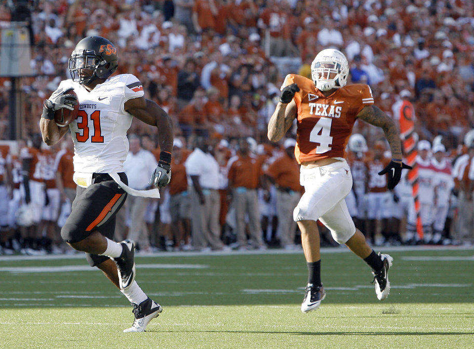 Photo - Oklahoma State's Jeremy Smith (31) runs in for a score as Texas' Kenny Vaccaro (4) chases him down during second half of a college football game between the Oklahoma State University Cowboys (OSU) and the University of Texas Longhorns (UT) at Darrell K Royal-Texas Memorial Stadium in Austin, Texas, Saturday, Oct. 15, 2011. Photo by Sarah Phipps, The Oklahoman
