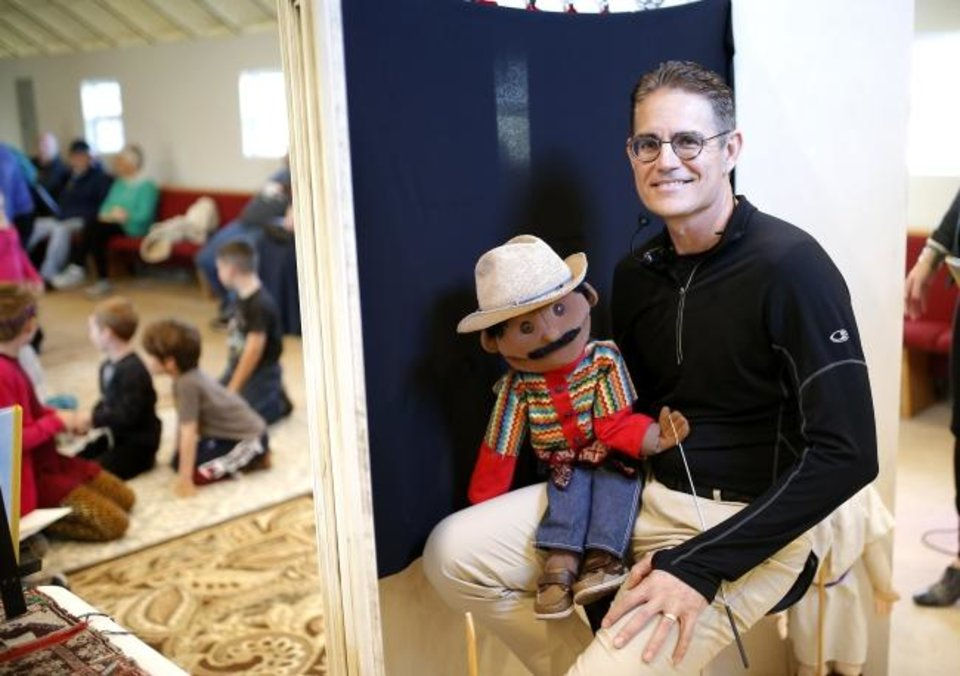 Photo -  James Bond of Norman poses with a puppet he uses to help his wife Susan Rother Bond tell the story of Blessed Stanley Rother. [Sarah Phipps/The Oklahoman]