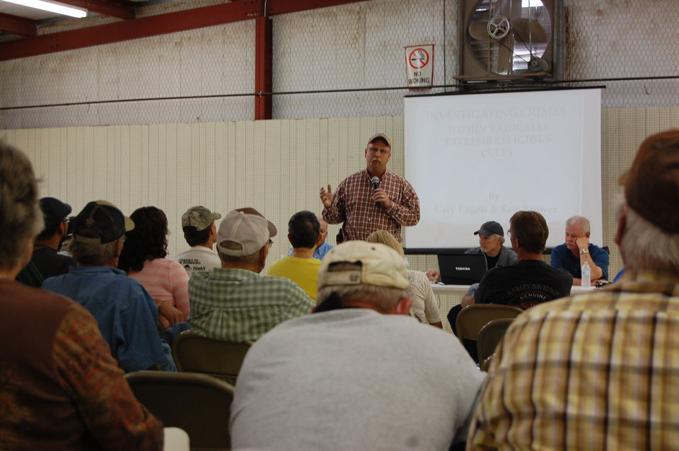 Photo - Cimarron County Sheriff Leon Apple tells Boise City residents gathered for a July 1 town hall meeting to remain civil. The meeting was held to discuss concerns over a large family associated with the Fundamentalist Church of Jesus Christ of Latter Day Saints.