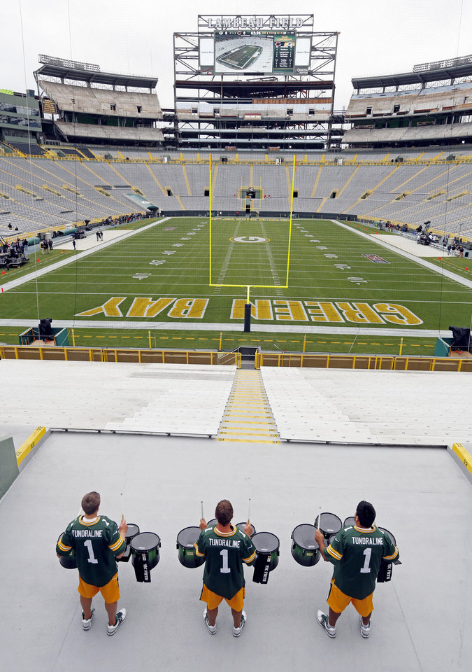 Photo -   Drummers practice at Lambeau Field before an NFL football game between the Green Bay Packers and the Chicago Bears Thursday, Sept. 13, 2012, in Green Bay, Wis. (AP Photo/Mike Roemer)
