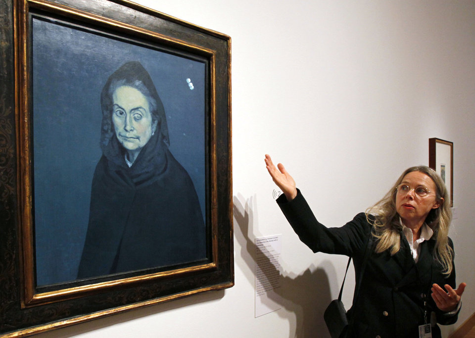 Photo - FILE - In this Oct. 5, 2010 file photo, Anne Baldassari, chief curator of Paris' Musee National Picasso, explains Pablo Picasso's