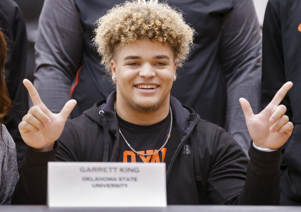 Photo - Westmoore's Garrett King announces he will be a preferred walk-on to play football for Oklahoma State University during national signing day at Westmoore High School in Moore, Okla. on Wednesday, Feb. 7, 2018.  Photo by Chris Landsberger, The Oklahoman