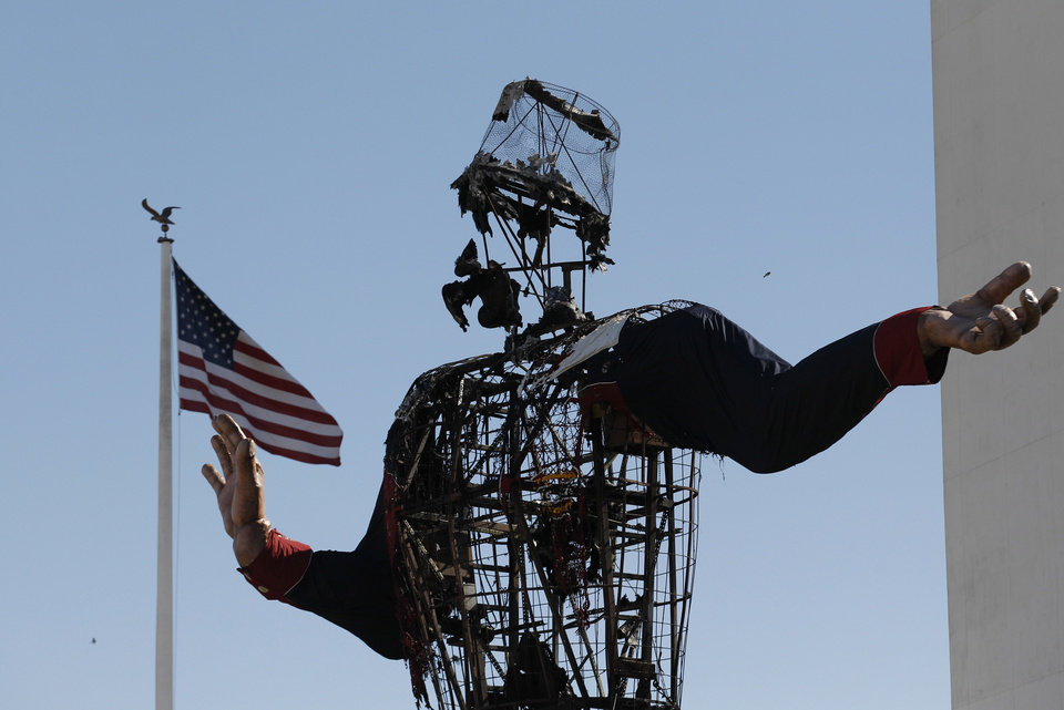 The burned remains of Big Tex stand at the State Fair of Texas Friday, Oct. 19, 2012, in Dallas. Fire destroyed Big Tex on Friday, leaving behind little more than the metal frame of the 52-foot-tall metal-and-fabric cowboy that is an icon of the State Fair of Texas. (AP Photo/LM Otero) ORG XMIT: TXMO101