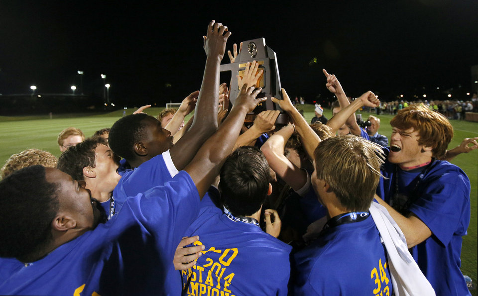 Photo - Heritage Hall celebrates with the championship trophy after the Class 5A boys soccer championship between Heritage Hall and Skiatook in Norman, Okla., Friday, May 16, 2014. Photo by Bryan Terry, The Oklahoman