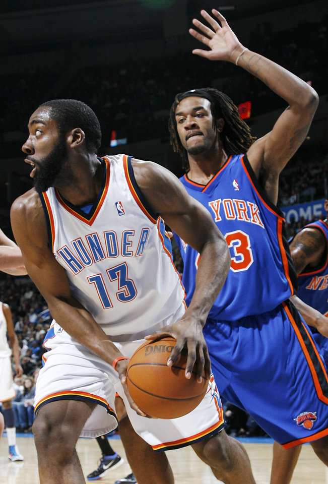 James Harden (13) of Oklahoma City moves away from Jordan Hill (43) of New York during the NBA basketball game between the Oklahoma City Thunder and the New York Knicks at the Ford Center in Oklahoma City, Monday, January 11, 2010. Oklahoma City won, 106-88. Photo by Nate Billings, The Oklahoman