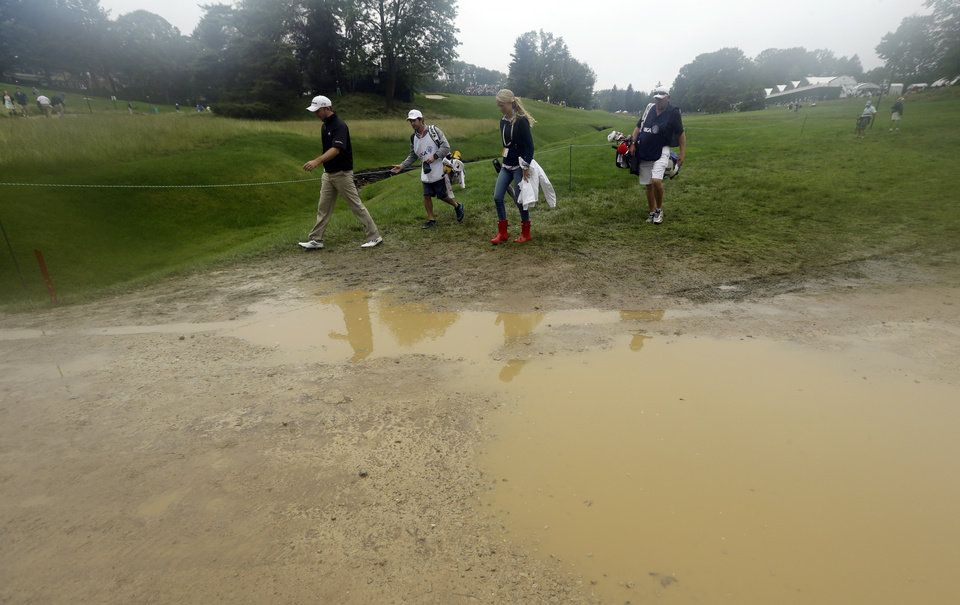 Photo - Martin Laird, left, of Scotland, walks near the fifth hole during the first round of the U.S. Open golf tournament at Merion Golf Club, Thursday, June 13, 2013, in Ardmore, Pa. (AP Photo/Julio Cortez)