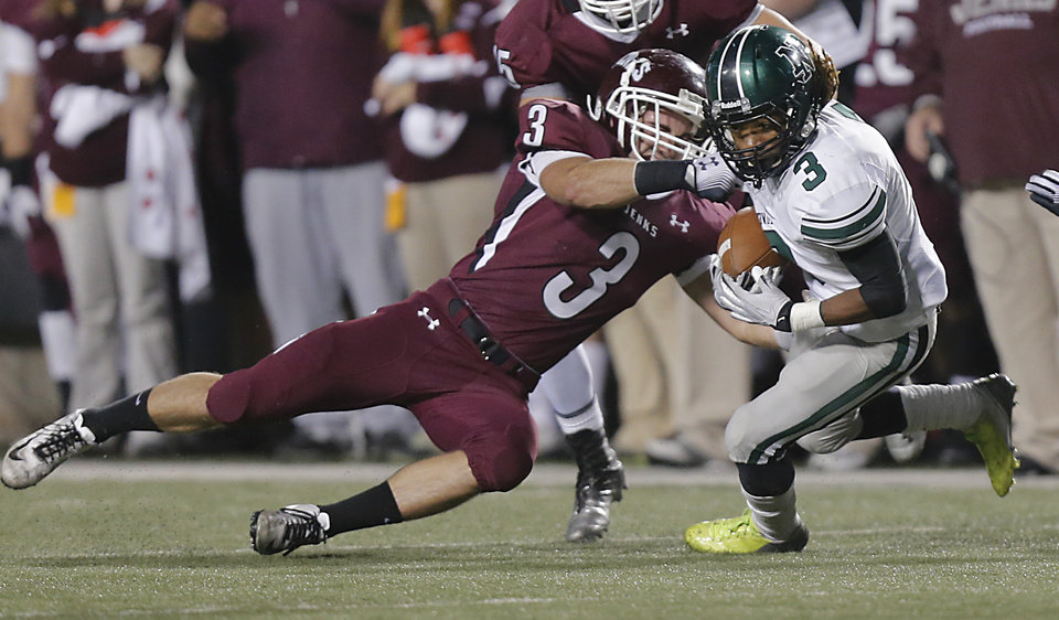 Jenks' Kent Clark (3) stops Norman North's Bryan Payne (3) during the Class 6A Oklahoma state championship football game between Norman North High School and Jenks High School at Boone Pickens Stadium on Friday, Nov. 30, 2012, in Stillwater, Okla.   Photo by Chris Landsberger, The Oklahoman