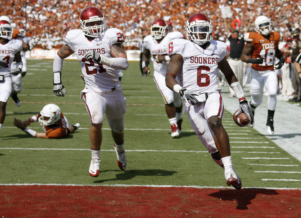 Oklahoma's Demontre Hurst (6) scores a touchdown after an interception during the Red River Rivalry college football game between the University of Oklahoma Sooners (OU) and the University of Texas Longhorns (UT) at the Cotton Bowl in Dallas, Saturday, Oct. 8, 2011. Photo by Bryan Terry, The Oklahoman
