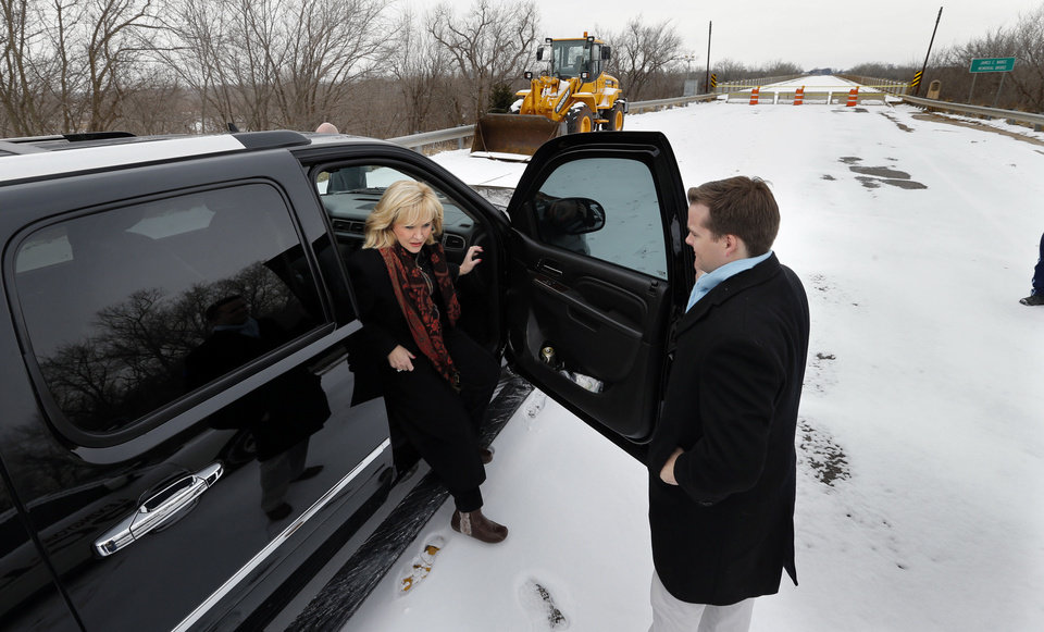 Photo - Governor Mary Fallin tours the U.S. 77/SH39 bridge between Purcell and Lexington and announces plans to repair it  on Friday, Feb. 7, 2014 in Lexington, Okla.  Photo by Steve Sisney, The Oklahoman