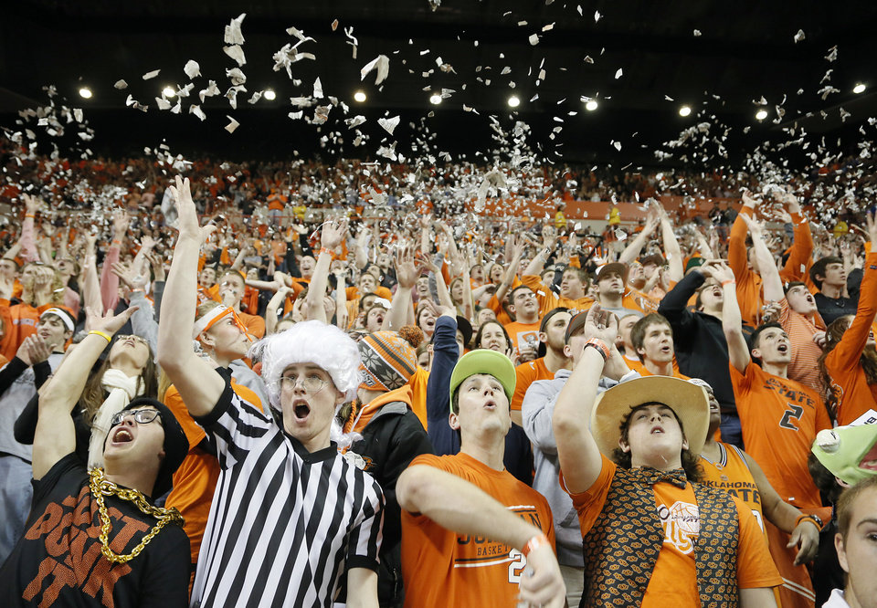 Photo - Oklahoma State fans cheer on the Cowboys during the college basketball game between the Oklahoma State University Cowboys (OSU) and the University of Kanas Jayhawks (KU) at Gallagher-Iba Arena on Wednesday, Feb. 20, 2013, in Stillwater, Okla. Photo by Chris Landsberger, The Oklahoman