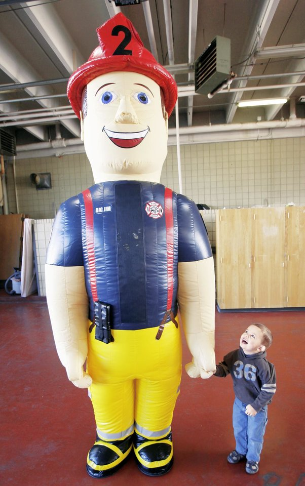 Jackson Sceili admires Big Jim,  an inflatable firefighter character. OKLAHOMAN ARCHIVE PHOTO BY STEVE GOOCH