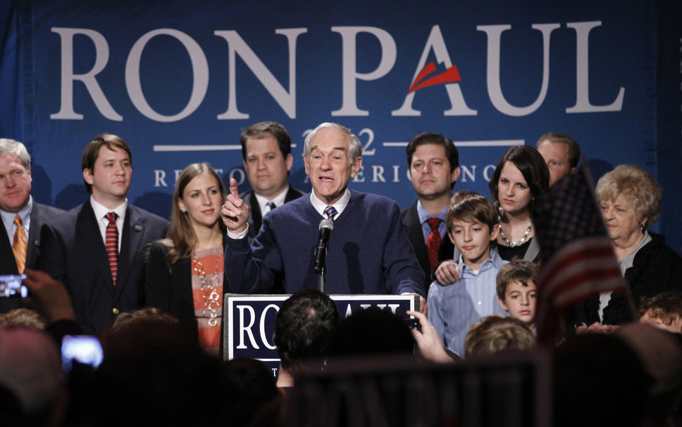 Photo - Republican presidential candidate Rep. Ron Paul, R-Texas, center, is joined on stage with members of his family during his South Carolina presidential primary election night rally in Columbia, S.C., Saturday, Jan., 21, 2012. Former House Speaker Newt Gingrich won the Republican primary Saturday night. (AP Photo/Pablo Martinez Monsivais) ORG XMIT: SCPM110
