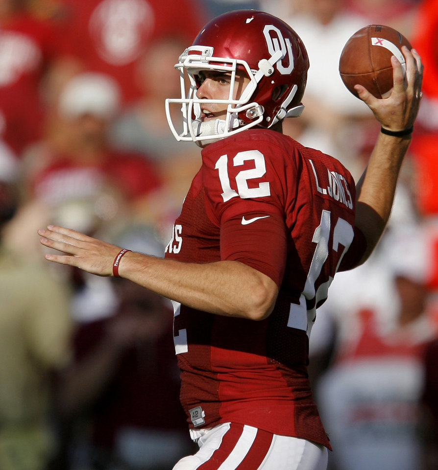 Photo - OU's Landry Jones passes the ball during the second half of the college football game between the University of Oklahoma Sooners (OU) and Florida State University Seminoles (FSU) at the Gaylord Family-Oklahoma Memorial Stadium on Saturday, Sept. 11, 2010, in Norman, Okla.   Photo by Bryan Terry, The Oklahoman