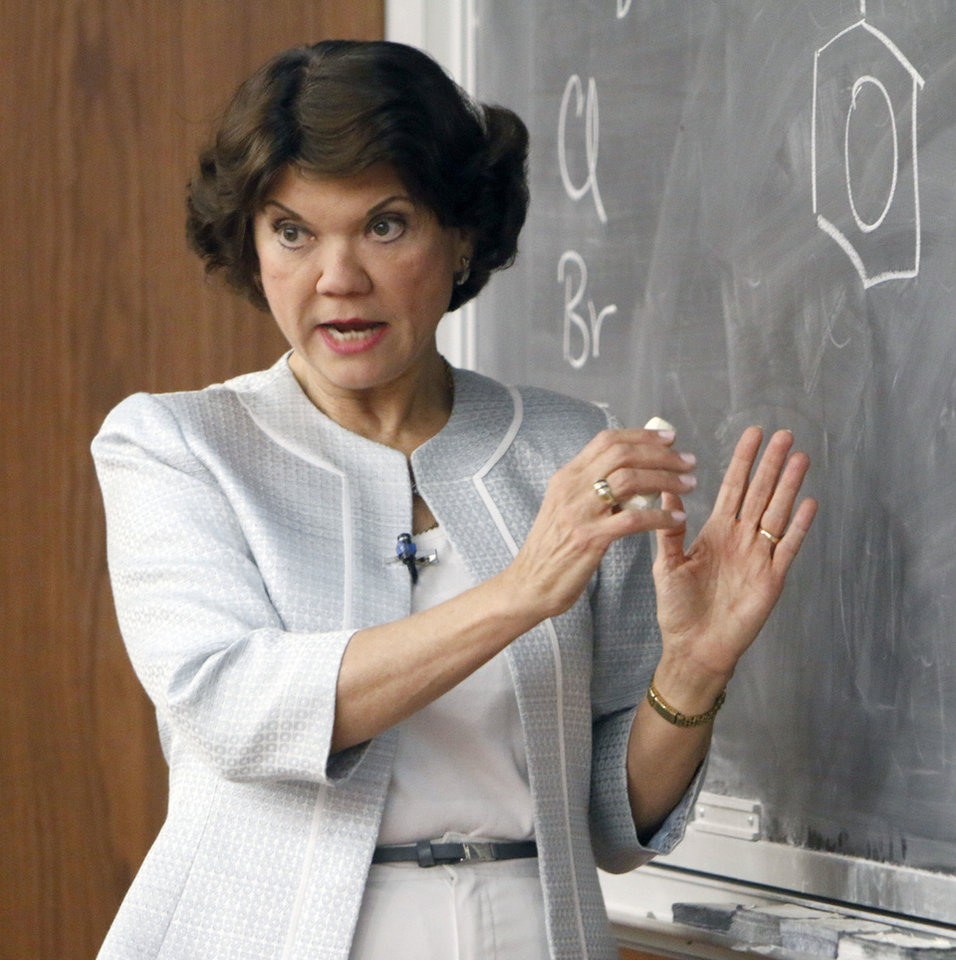 Photo - OU Chemestry professor Donna Nelson teaches an organic chemistry course at the University of Oklahoma. Professor Nelson was a science advisor for