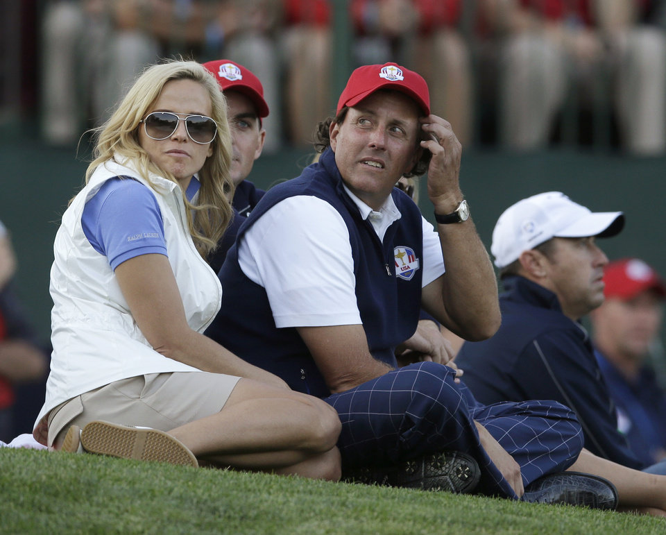 Photo -   USA's Phil Mickelson and wife Amy watch USA's Tiger Woods and Steve Stricker during a four-ball match at the Ryder Cup PGA golf tournament Friday, Sept. 28, 2012, at the Medinah Country Club in Medinah, Ill. (AP Photo/Chris Carlson)