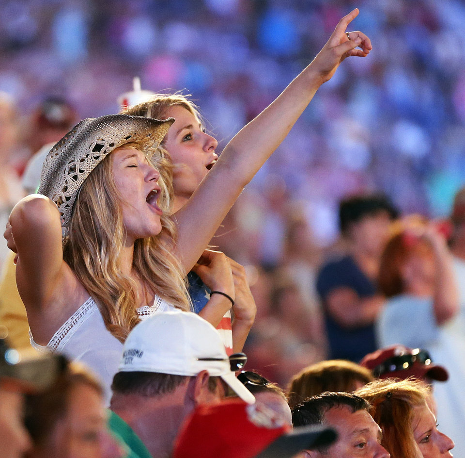 Photo - Fans cheer as Toby Keith performs during the Oklahoma Twister Relief Concert, benefiting victims of the May tornadoes, at Gaylord Family - Oklahoma Memorial Stadium on the campus of the University of Oklahoma in Norman, Okla., Saturday, July 6, 2013. Photo by Nate Billings, The Oklahoman