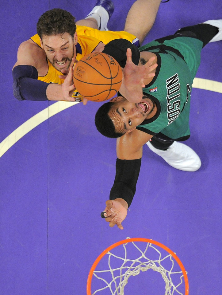 Photo - Los Angeles Lakers center Pau Gasol, left, of Spain, and Boston Celtics center Jared Sullinger battle for a rebound during the first half of an NBA basketball game, Friday, Feb. 21, 2014, in Los Angeles. (AP Photo/Mark J. Terrill)