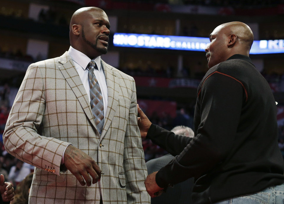 Team Shaq coach Shaquille O'Neal, left, and former NBA player Karl Malone talk during the second half of the Rising Stars Challenge basketball game at NBA All-Star Weekend, Friday, Feb. 15, 2013, in Houston. (AP Photo/Eric Gay)