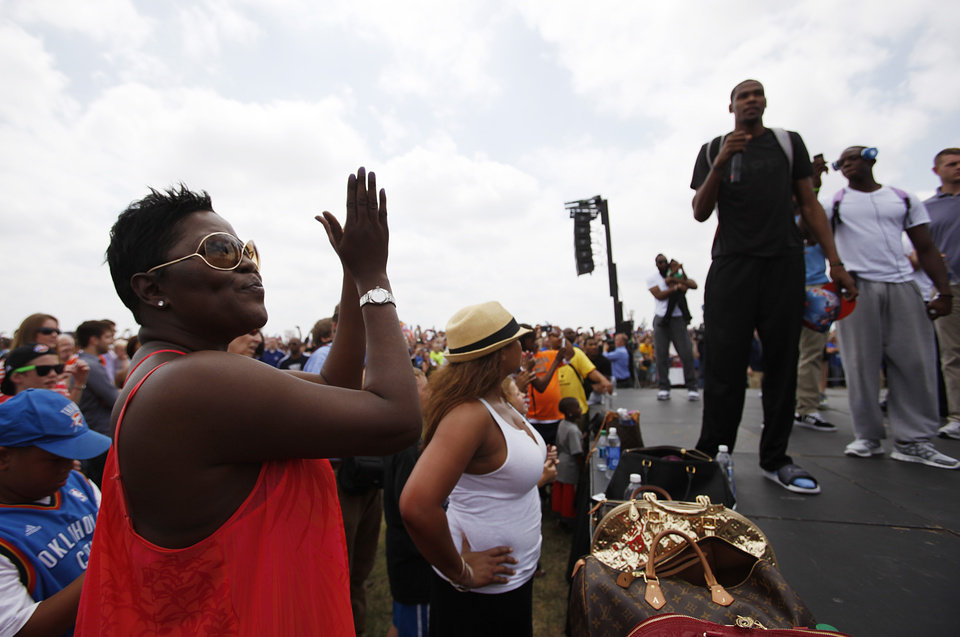 Photo - Wanda Pratt cheers while her son, Kevin Durant, speaks during a welcome home rally for the Oklahoma City Thunder at a field near Will Rogers Airport in Oklahoma City, Friday, June 22, 2012.  Photo by Garett Fisbeck, The Oklahoman