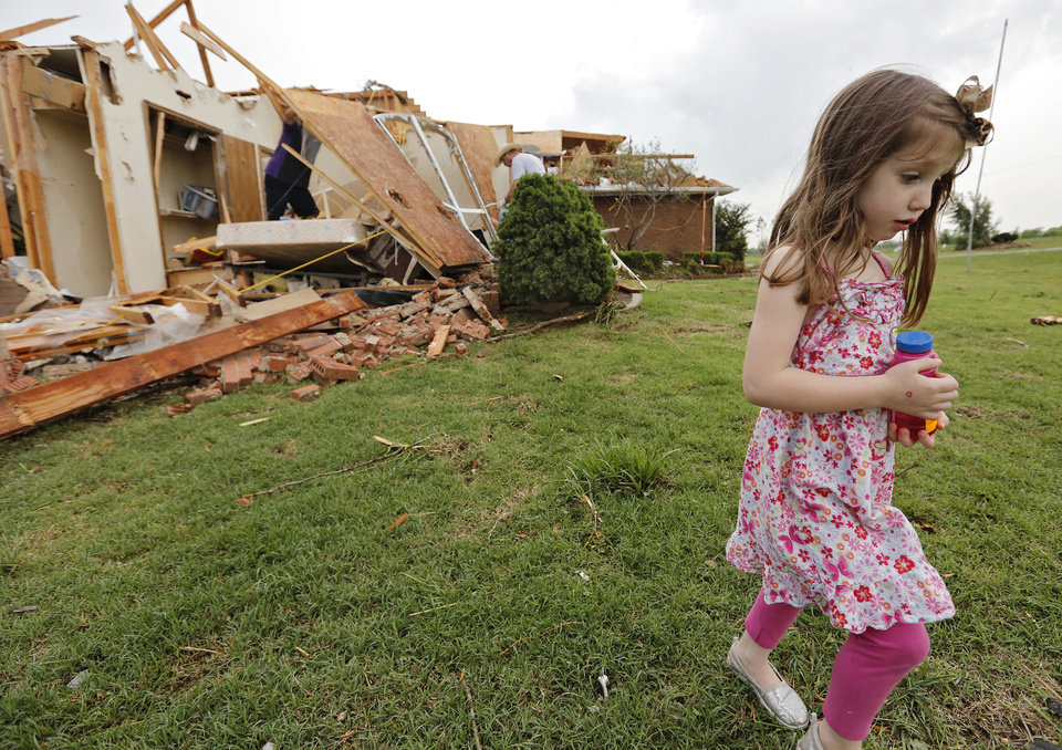 Magen Stanley, 5, walks away from her grandparents destroyed home after a tornado hit the area near 149th and Drexel on Monday, May 20, 2013 in Oklahoma City, Okla.  Photo by Chris Landsberger, The Oklahoman